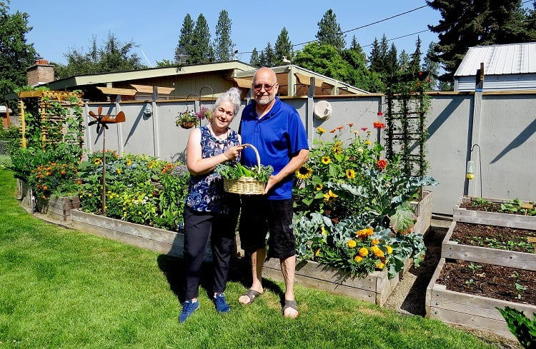Couple Holding Veggies